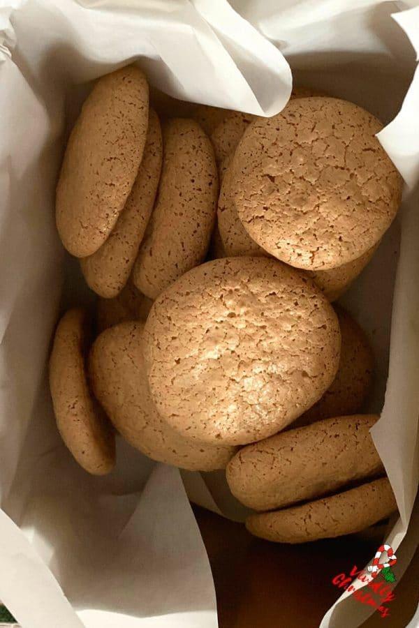 Delicious walnut meringue cookies in cookie jar