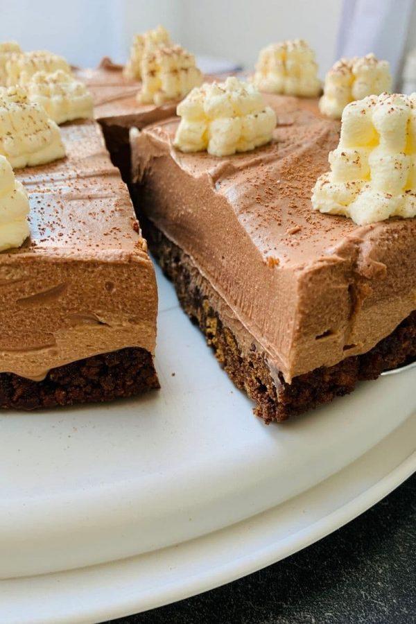 Lotus Biscoff cookie base, milk chocolate ricotta cream, dark chocolate ricotta cream, whipped cream decorations.